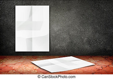 room with hanging blank crumpled white poster at black stone wall and falling poster at vintage pattern brick floor,Template Mock up for display of your content