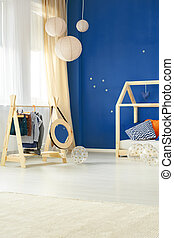 Room with kids clothes rack - Modern room with kids clothes...