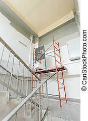 Room with ladders during under renovation, remodeling and construction