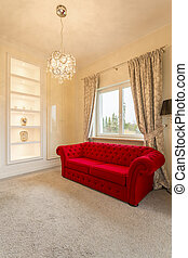 Room with luxurious couch - Bright room with luxurious red...