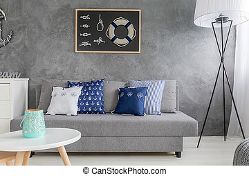 Room with sailing motives - Cyan room with grey couch, lamp...