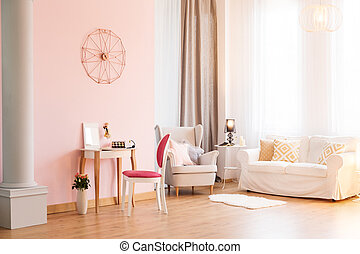 Room with sofa and armchair