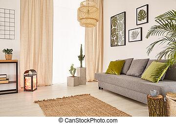 Room with sofa and window - Light room with grey sofa, green...