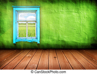 room with window with field and sky above it