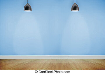 Room with wooden floor lighted with spotlights