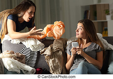 Roommate scolding her messy friend