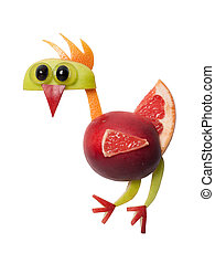 Rooster made with apple and grape on white background