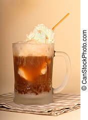 Root beer float in frosted glass and straw - A root beer...