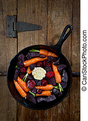 Root Vegetables in a Cast Iron Skillet - Raw root vegetables...