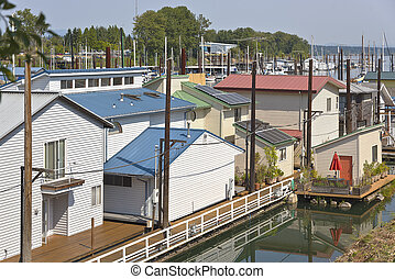 Rootops and floating houses in a marina.