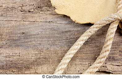 Rope And Leather On Wood Table