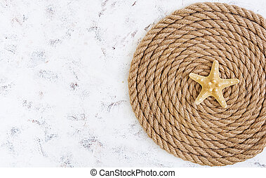 Rope and starfish on white background. Top view