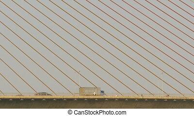 Rope bridge and sling of bridge with traffic