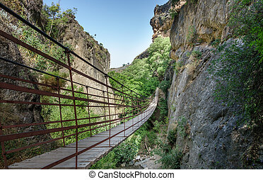 Rope bridge over a canyon in Cahorros, Granada, - Wide angle...