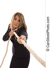 Rope - Business woman pulling a rope isolate on white...