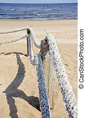 rope fence on sea resort beach
