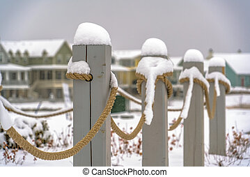 Rope fence topped with snow in Daybreak Utah