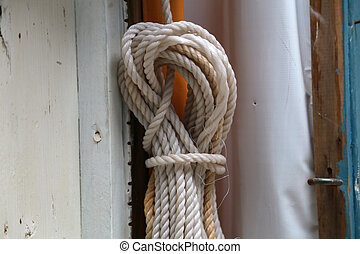 rope hanging on the wall