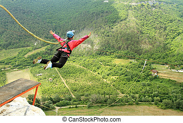 Rope jumping - Bungee jumping sequence in Banos de Agua...