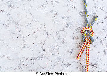 Rope knot on white background. Top view