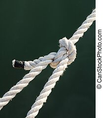 Rope knot - Tight knot on a white rope - closeup