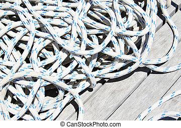 Rope lying on a wooden bridge