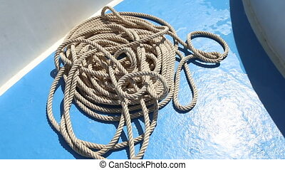 rope lying on deck of ship