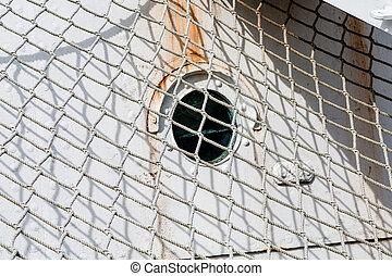 Rope Net Over Rusty Hull