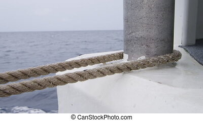 Rope on a metal bar - A medium shot of a rope on a metal...