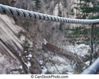 Rope on a suspension bridge in the mountains, close-up