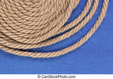 Rope on blue background with copy space