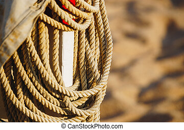 Rope On Boat's Deck. Hanging rope wool close-up on blurred background. marine rope. Ship Rope