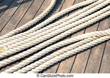 Rope on old wooden board
