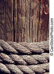 rope on weathered wood background
