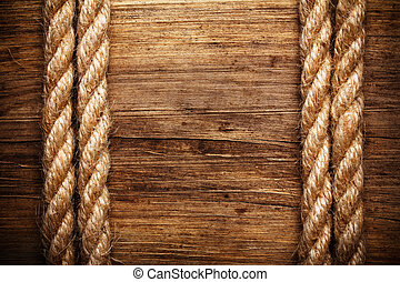 rope on weathered wood background