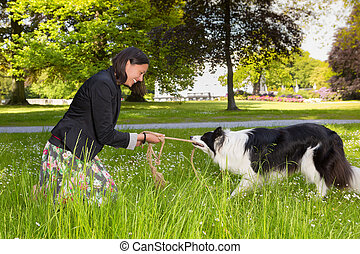 Rope pulling with her dog