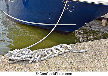 rope securing a boat in slip