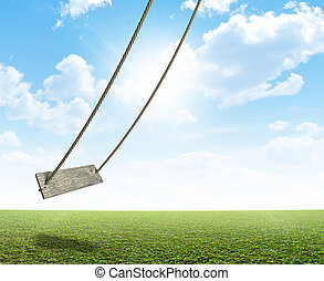 Rope Swing On Green Field - A regular home made swing made...