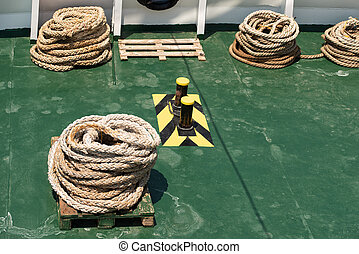 Rope teirs on the green sea vessel deck - Rope teirs on the ...