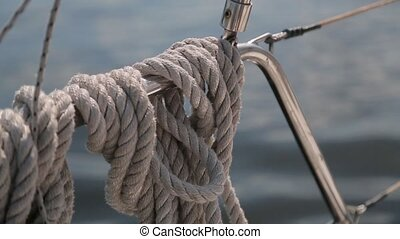 Rope tied to the railing of a yacht