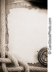 ropes and compass on old vintage ancient paper background