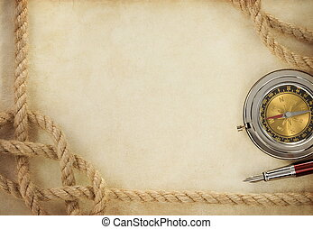 ropes and compass on old vintage ancient paper