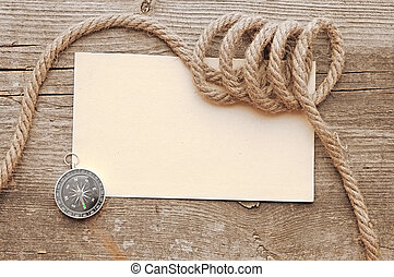 ropes and compass on old vintage ancient paper background texture