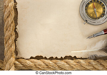 ropes and compass on old vintage paper background