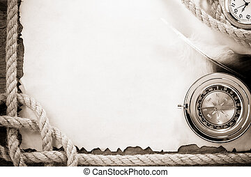 ropes and compass on vintage ancient paper background