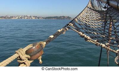 Ropes of a boat and sea - A medium shot of boat ropes and...