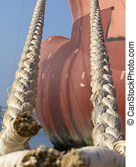ropes on the Bulbous bow of dry cargo ship docked in harbor
