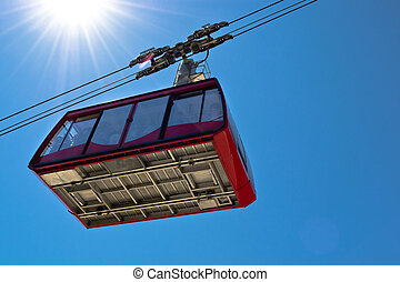 Ropeway wagon moving to the peak