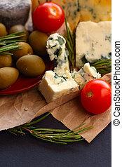 Roquefort cheese composition on dark background