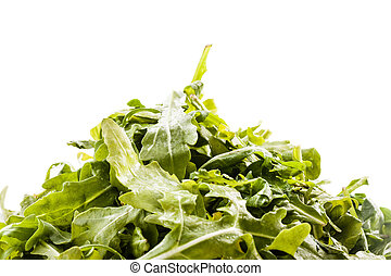 Roquette heap - a heap of roquette salad isolated over a...